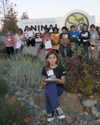 Students in front of animal shelter sign